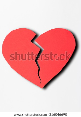 Broken heart shape of red paper for love theme on Valentine concept. A heart is the symbol of love and romance then it can apply for background,backdrop,wallpaper and artwork design.
