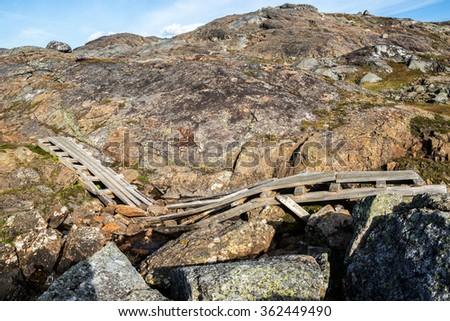 Broken Hikingbridge in the Swedish Mountains - stock photo