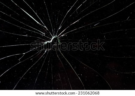 broken horizontal glass black background - stock photo