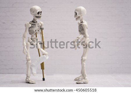 Broken leg skeleton chatting with his friend