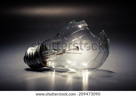 Broken light bulb as symbol of thoughtless or problem in thinking concept - stock photo