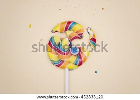 Broken lollipop - stock photo