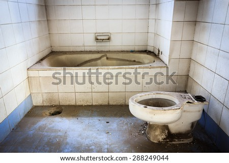 Broken old abandoned dirty toilet bowl - stock photo