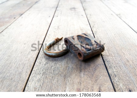 broken padlock on wood - stock photo