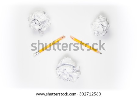 Broken Pencil and crumpled paper on white background - stock photo