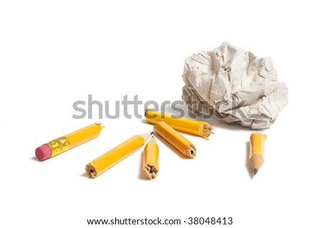 Broken Pencil Pieces and Paper Ball on White Background