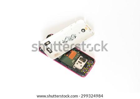 broken phone on white background - stock photo