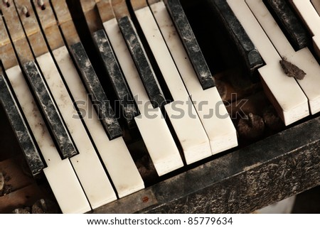 broken piano keyboard - stock photo