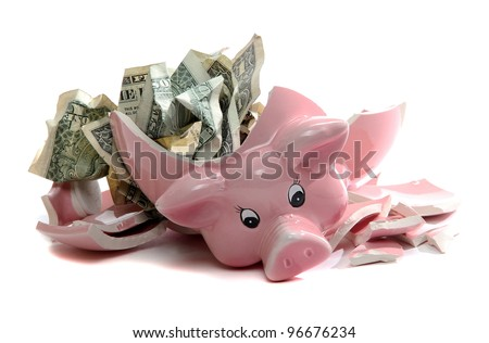 broken piggybank with dollar notes - stock photo