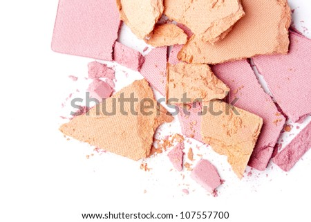 broken pink and orange eyeshadow isolated on white background - stock photo