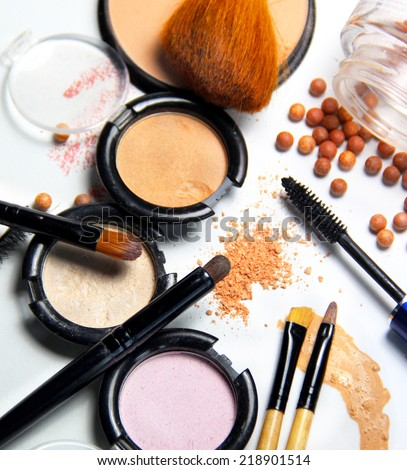 Broken powder, foundation and brushes on the white background - stock photo