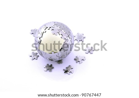 broken puzzle glob, planet Earth with empty memo card - stock photo