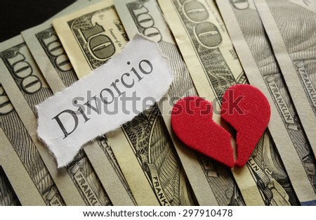 Broken red heart and Divorcio paper note on cash                                - stock photo