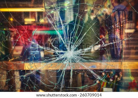 Broken shop window with color background - stock photo