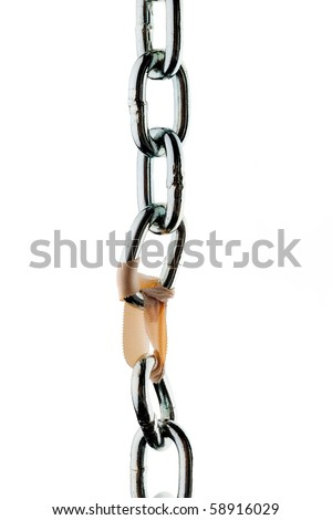 Broken steel chain is held together by a paperclip - stock photo