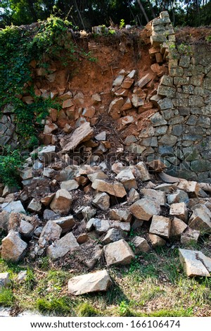 Broken stone wall after earthquake. - stock photo