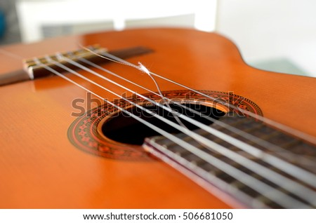Broken string on a classical guitar, Close-up guitar body