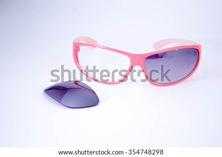 broken sunglasses isolated on white background