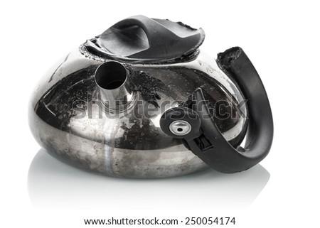 Broken teapot isolated on white background - stock photo