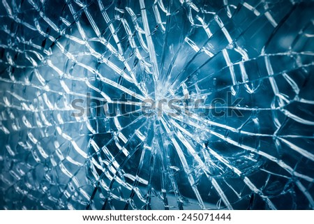 broken tempered glass closeup , background of glass was smashed - stock photo