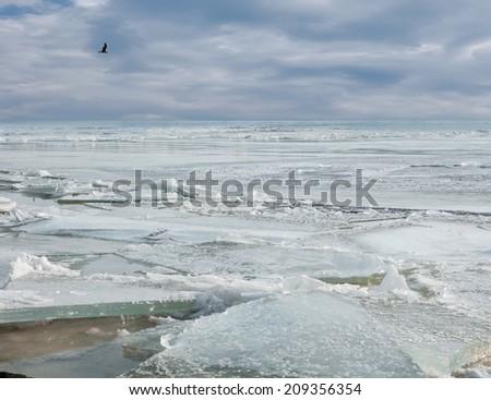 broken the ice on the sea in winter - stock photo