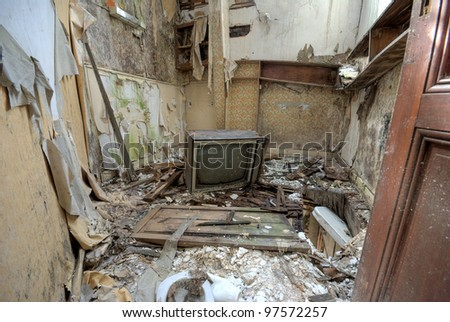 Broken Tv in an abandoned house - stock photo
