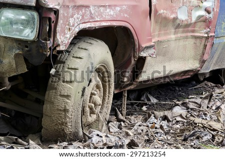 Broken wheel of old pick-up car stand on the ground  - stock photo