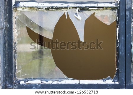 Broken window at an old house - stock photo