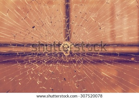 Broken window, cracked glass on urban background