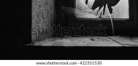 Broken window glass - abandoned mental hospital - stock photo