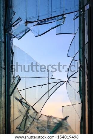 Broken window glass fragments detail - stock photo