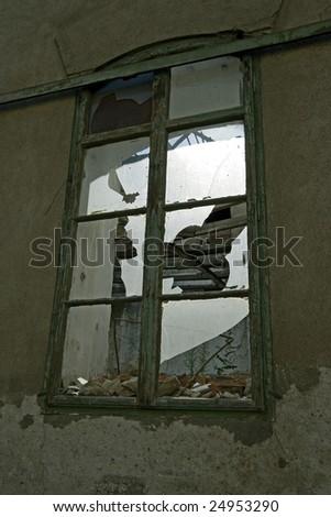 broken window in a ruin house - stock photo