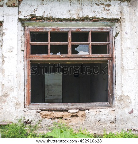 Broken window of an abandoned building