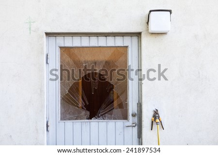 Broken Window on a door - stock photo