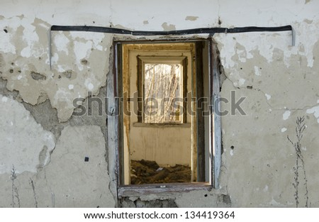 broken windows in an old ruined building, fragment of wall and window, vertical - stock photo