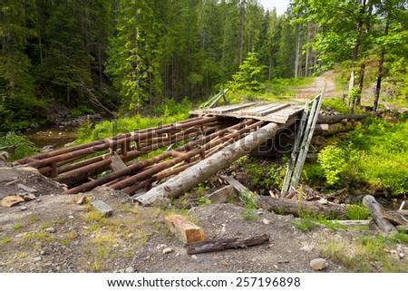 Broken wooden bridge  - stock photo