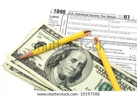 broken yellow pencil over dollars and 1040 tax form - stock photo