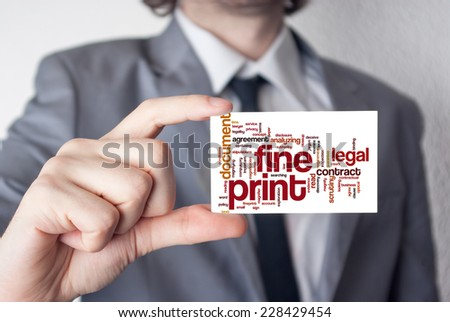 Broker. Businessman in suit with a black tie showing or holding business card. - stock photo