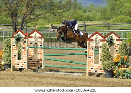 BROMONT-CANADA JULY 21: Unknown rider on a horse during 2012, INTERNATIONAL BROMONT on July 21, 2012 At the Equestrian 1976 Montreal Olympic Park. - stock photo