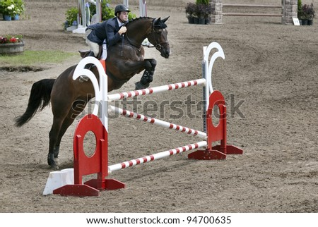 BROMONT-CANADA JULY 29: Unknown rider on a horse during 2011, INTERNATIONAL BROMONT on July 29, 2011 At the Equestrian 1976 Montreal Olympic Park. - stock photo
