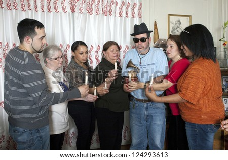 BRONX, NEW YORK - DECEMBER 23: Yomo's family unites in prayer to remember cuatro player Yomo Toro who died before being able to accept the Latin Grammy award. Taken December 23, 2012  Bronx, NY.