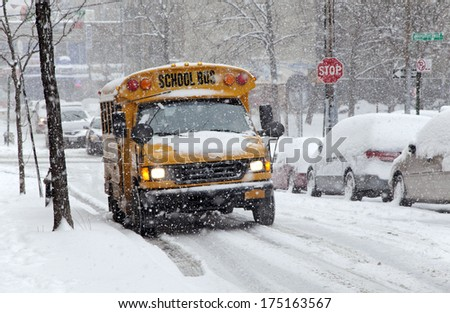 BRONX, NEW YORK - JANUARY 21: School bus during a 6 to 10 inch snow storm with teen temperatures along Ogden avenue and 162nd street.  Taken January  21,  2014 in the Bronx,  New York.