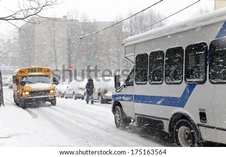 BRONX, NEW YORK - JANUARY 21: Street traffic during a 6 to 10 inch snow storm with teen temperatures along Ogden avenue and 162nd street.  Taken January  21,  2014 in the Bronx,  New York. - stock photo