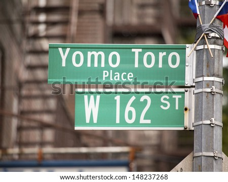 BRONX, NEW YORK - JULY 27: City sign erected in honor of legendary cuatro player Yomo Toro. Taken day of it's unveiling July 27, 2013 at Yomo Toro Place, Ogden avenue, in New York. - stock photo