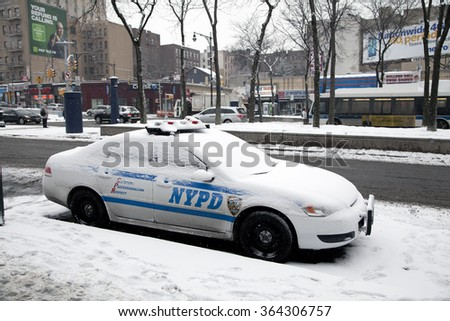 BRONX, NEW YORK, USA - FEBRUARY 19: Police vehicle parked with snow on it.  Taken February 19, 2015 in the Bronx,  New York.