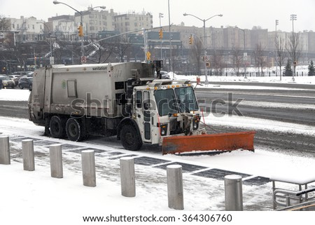 BRONX, NEW YORK, USA - FEBRUARY 19: Sanitation truck performs street snow cleaning.  Taken February 19, 2015 in the Bronx,  New York. - stock photo