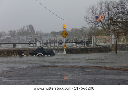 BRONX, NY - OCTOBER 29: Hurricane Sandy begins it's wrath and starts going over the sea wall in Bronx, NY, U.S., on Monday, October 29, 2012. - stock photo