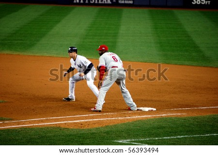 BRONX, NY - OCTOBER 29: Mark Teixeira of the Yankees leads off first base as Ryan Howard of the Phillies covers during game 2 of the World Series on October 29, 2009 in the Bronx, NY