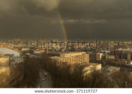 Bronx, NY USA - January 10, 2016: Unusually warm winter produced thunderstorm in the Bronx and double rainbow after