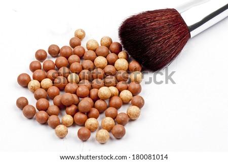Bronze beads blush with makeup brush isolated on white background - stock photo